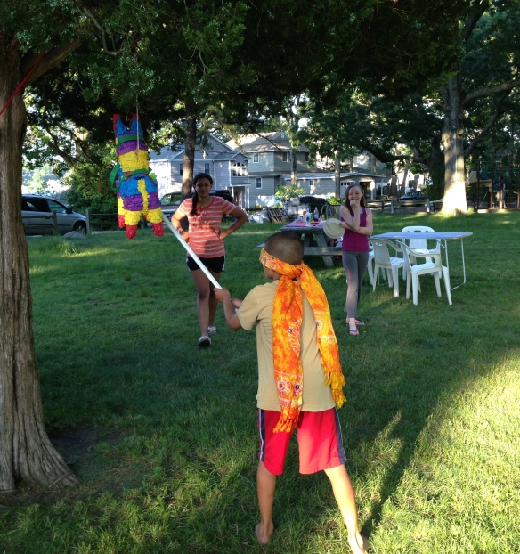 Ethan vs. the piñata!